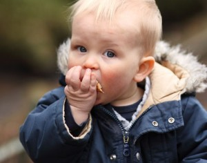 Boy eating bread